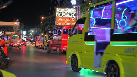 Traditional Tuk-tuk Taxi in the Night Streets of Patong Beach. Public Transport Footage