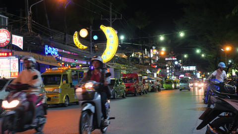 Timelapse: Traditional Tuk-tuk Taxi in the Night Streets of Patong Beach. Public Footage