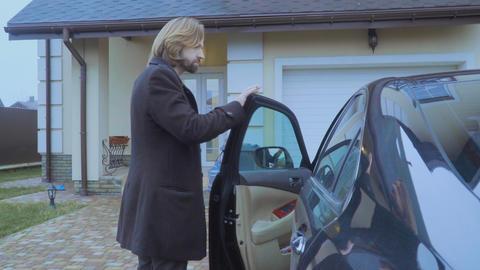 Handsome man returns at home after work Footage