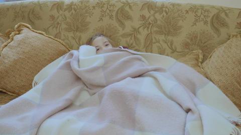 Little girl hides under blanket Live Action