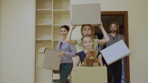 Happy family with boxes in a new house Footage