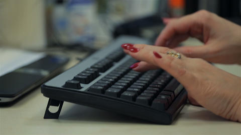 Adult woman typing on black keyboard. Close up Stock Video Footage