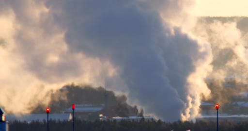 Dense steam rises, early morning, backlight. Telephoto lens, Mirage in the Footage