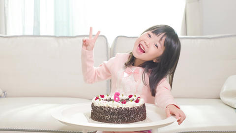 cute girl with birthday cake Live Action