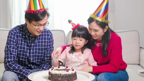 happy family with birthday cake Live Action