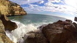 Waves splashing at rocks, slow motion Footage