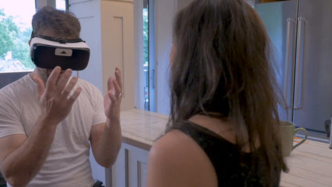 Happy man wearing a VR headset having a virtual reality experience gently Footage
