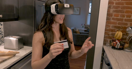 Beautiful woman in early 30s selecting items in a virtual reality store wearing Footage