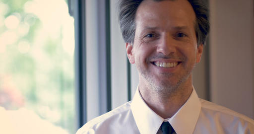 Portrait of attractive man with a shirt and tie nodding and smiling while Footage