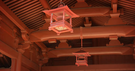Decorative Lanterns Hang from Buddhist Temple Ceiling in Hong Kong GIF