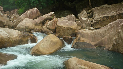 River in Vietnam Flows around Boulders. with Sound GIF