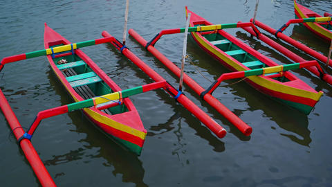 Small. Outrigger Canoes. Painted in Bold. Cheerful Colors GIF