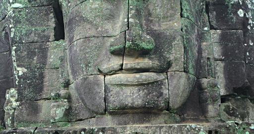 Closeup of Ancient Stone Face at Bayon Temple in Cambodia GIF