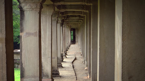 Perspective of Ancient Stone Columns at Angkor Wat in Cambodia GIF