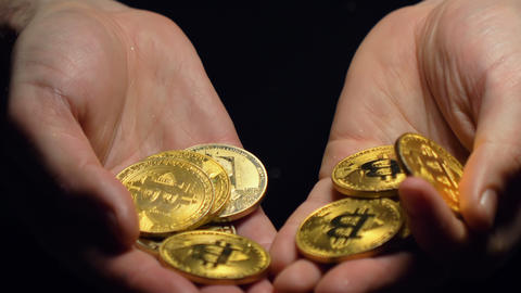 Hands Hold Bitcoin Real Model Pile against Darkness Closeup Live Action