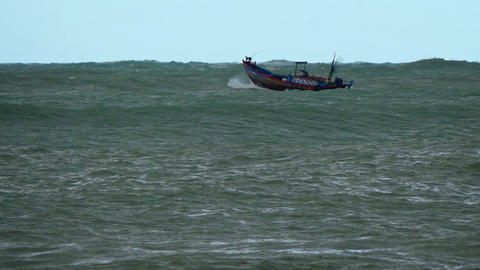 Small Fishing Boat on Rough Seas in Vietnam Live Action