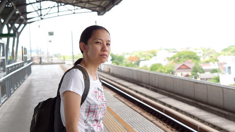 Video of Asian tourist at train station. Feeling lost and confuse Live Action