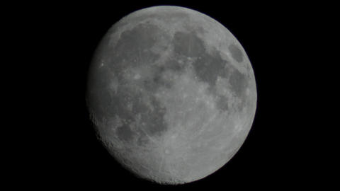 The moon captured through a telescope Live Action