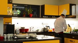 chef cooks food in the kitchen (home) Footage