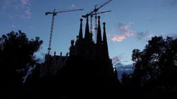 Black Sagrada Familia silhouette against blue evening sky, tilt up shot ビデオ