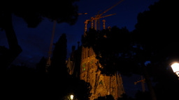 Sagrada Familia dim illuminated at night, low angle shot in motion Footage