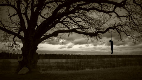 hanged man on gloomy background long shot Footage