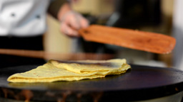 chef prepares a pancake - closeup Footage