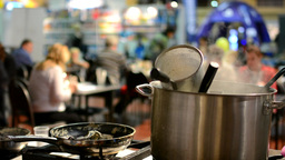 cooking stove with cookware - pots and empty pan - steam - restaurant (people) i Footage