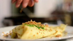 chef prepares a pancake - pour with spinach Footage