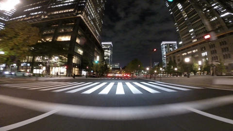 Busy commuters and illumination on office buildings in front of Tokyo Station at Footage
