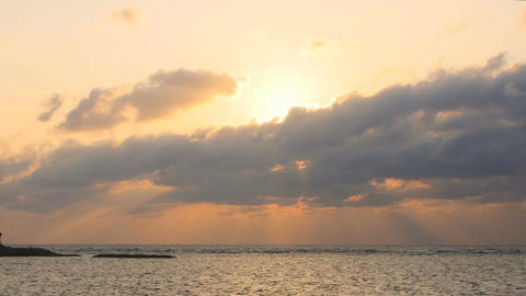 Zoom out shot from sunset over the Emerald beach in Okinawa ビデオ