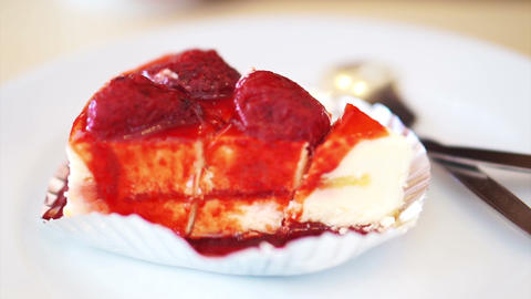 Eating and cutting white fluffy strawberry cheesecake Footage
