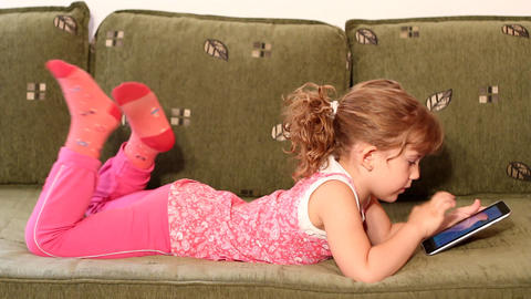 little girl play with tablet pc Live Action