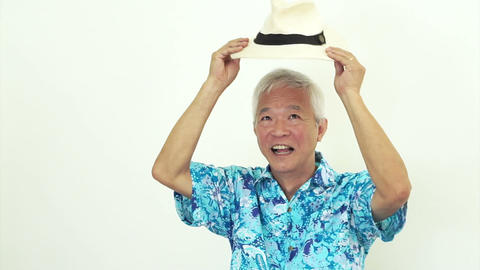 Asian Senior Man Wearing Blue Hawaii Shirt And Hat. Ready To Go Vacation stock footage