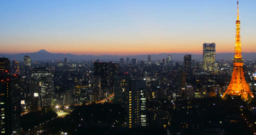High angle view of Tokyo city at twilight with Tokyo Tower and Mt Fuji on the ba Footage