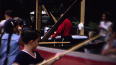 1962: Kids bamboo cane fishing county fair game prizes Footage