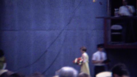 1962: Beauty pageant contest winner trophy flower bouquet Footage