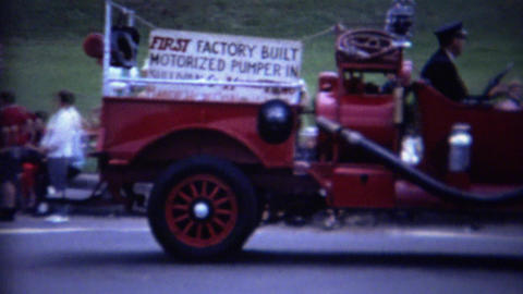 1962: Old timey fire truck first factory build motorized pumper Footage