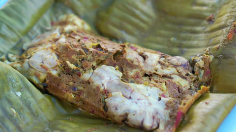Thai local food. South East Asia weird food. Pig brain in banana leave, blood mi Live Action