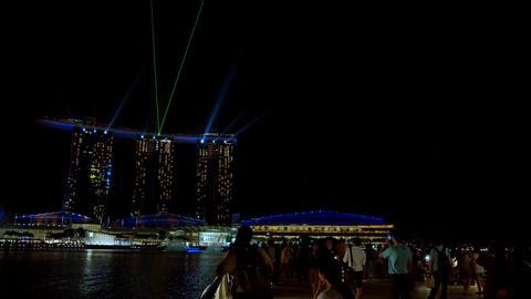 Tourists enjoying dramatic evening light show of Sands at Marina Bay. Singapore Footage