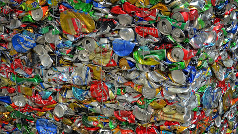 Closeup of aluminum beverage cans in compacted bale for recycling in Hong Kong Live Action