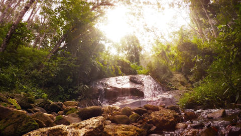 Psychedelic natural landscape. Tropical rainforest. waterfall and sun rays Live Action