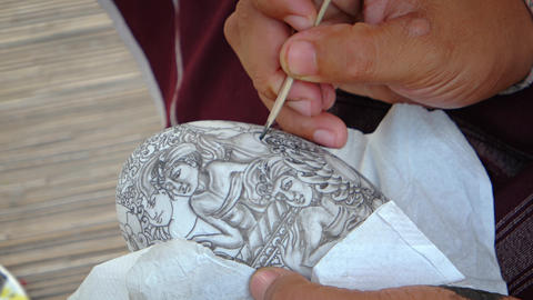 Local Artist Demonstrates Traditional. Balinese Art at Taman Nusa Cultural Park Footage