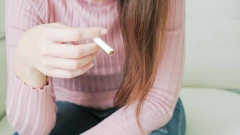 woman breaking a cigarette Footage