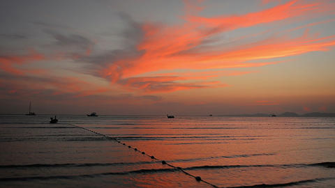 Colorful Sunset over Thai Tropical Beach Paradise with Boats Footage
