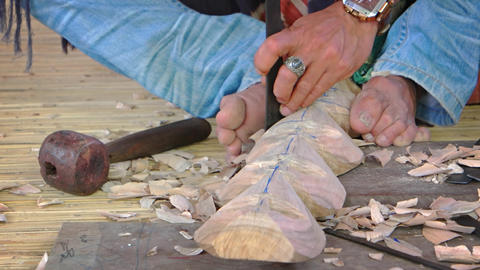 Local Artist Carving Wood with Traditional Tools in Indonesia Footage