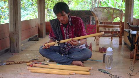 Local Artisan Carving Native Bamboo Flutes by Hand at Taman Nusa Cultural Park Live Action