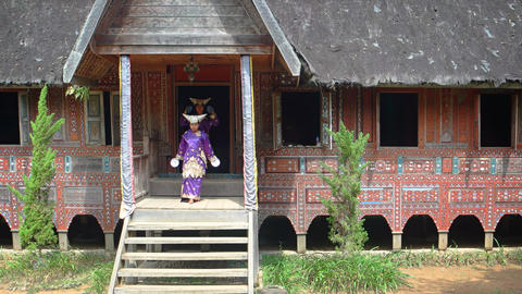 Two Women Demonstrating Balinese Native Dance on Porch of House Footage
