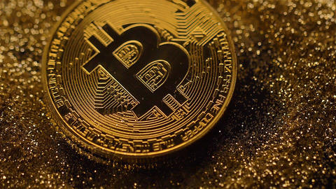 Glowing Bitcoin Model Falls down and Shines Macro Footage