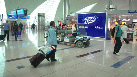 Staff Driving a Golf Cart through Main Concourse at the International Airport Footage